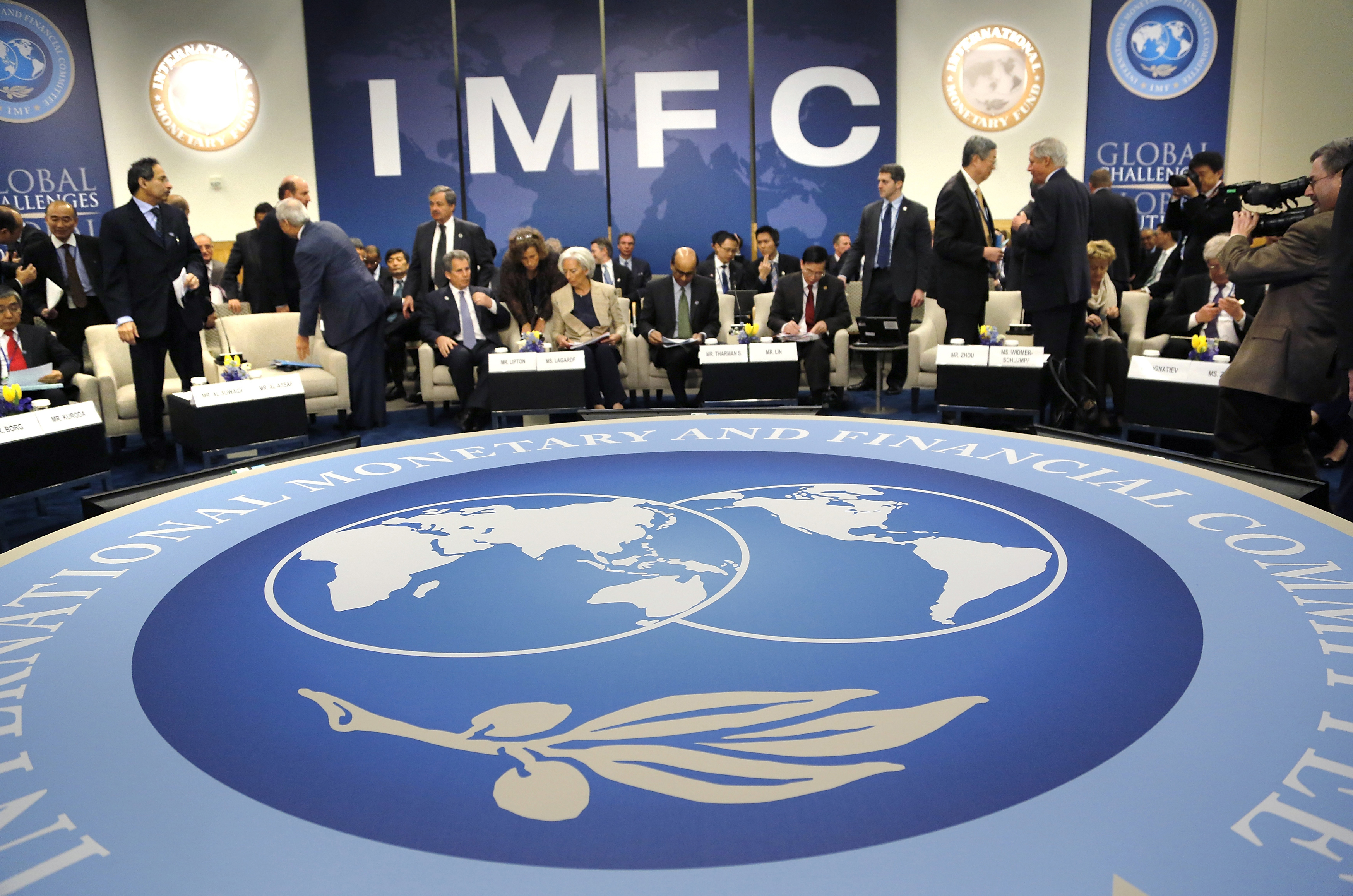 Delegates arrive for an IMFC plenary session during the IMF and World Bank spring meetings in Washington