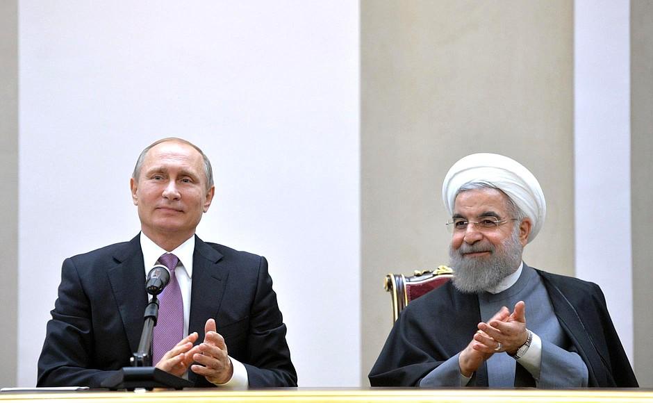الرئيس الروسي فلاديمير بوتين مع رئيس إيران روحاني